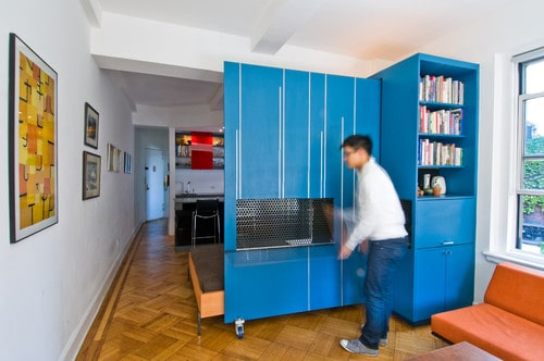 A customised storage area with a murphy bed